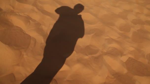 Man Shadow on the Sand Desert