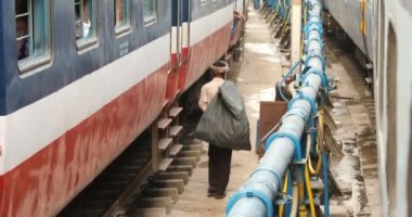 Cleaning People at Train Station,Hyderabad,India