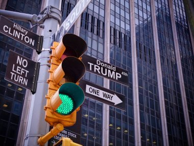 New York Wall street yellow traffic light black white fake pointer guide: political double sense: Green light, one way green light to Donald Trump, 45th USA american president, No turn to Hillary Clinton policy
