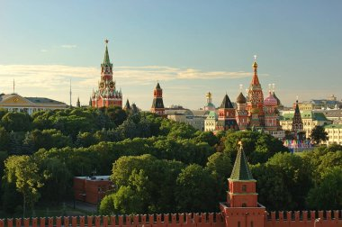 Evening view on Moscow Red Square Kremlin towers red square wall stars and Clock Kuranti Saint Basil Cathedral church. Panorama from Sofiyskiy bell tower. Moscow holidays vacation famous sightseeing
