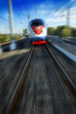 Amazing beautiful impressive front view on moving white red blue beautiful high speed passenger train. Motion blur. Moscow high speed trains rail tracks. Russian train