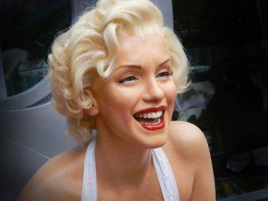 LOS ANGELES, NOV.14, 2014: Marilyn Monroe waxwork portrait at Los Angeles street. Merlin Monroe celebrity. Waxwork celebrities of Hollywood Walk of Fame. Famous stars. Young girl woman portrait