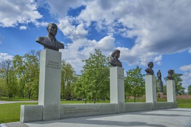 MOSCOW, APRIL 12, 2017: Soviet cosmonauts portrait sculpture busts and space rocket on Moscow cosmonaut space museum roof. Space museum monument. Alley of cosmonauts. Famous sighseeing for tourists