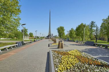 MOSCOW, MAY 18, 2017: Soviet Cosmonauts Alley, memorial stars, cosmonauts busts and space and aeronautic museum Rocket monument on VDNKh. Famous space sculptures, city parks gardens flowers. Gagarin