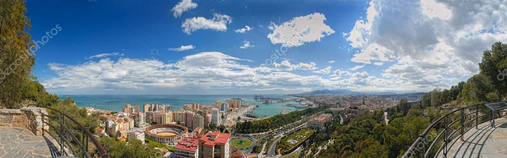 Panoramic view on Malaga city down town center Mediterranean Sea port harbor bullfight theater from antique castle Castillo de Gibralfaro. Traditional and modern Spain architecture. Gibraltar area