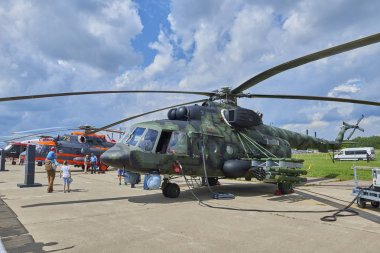 ZHUKOVSKY, RUSSIA, JUL. 21, 2017: Aerospace aircraft exhibition MAKS 2017. Green pixel camouflage Russian military helicopter Mi-8. Armored armed famous Russian helicopter Mi-8. Russian miitary copter