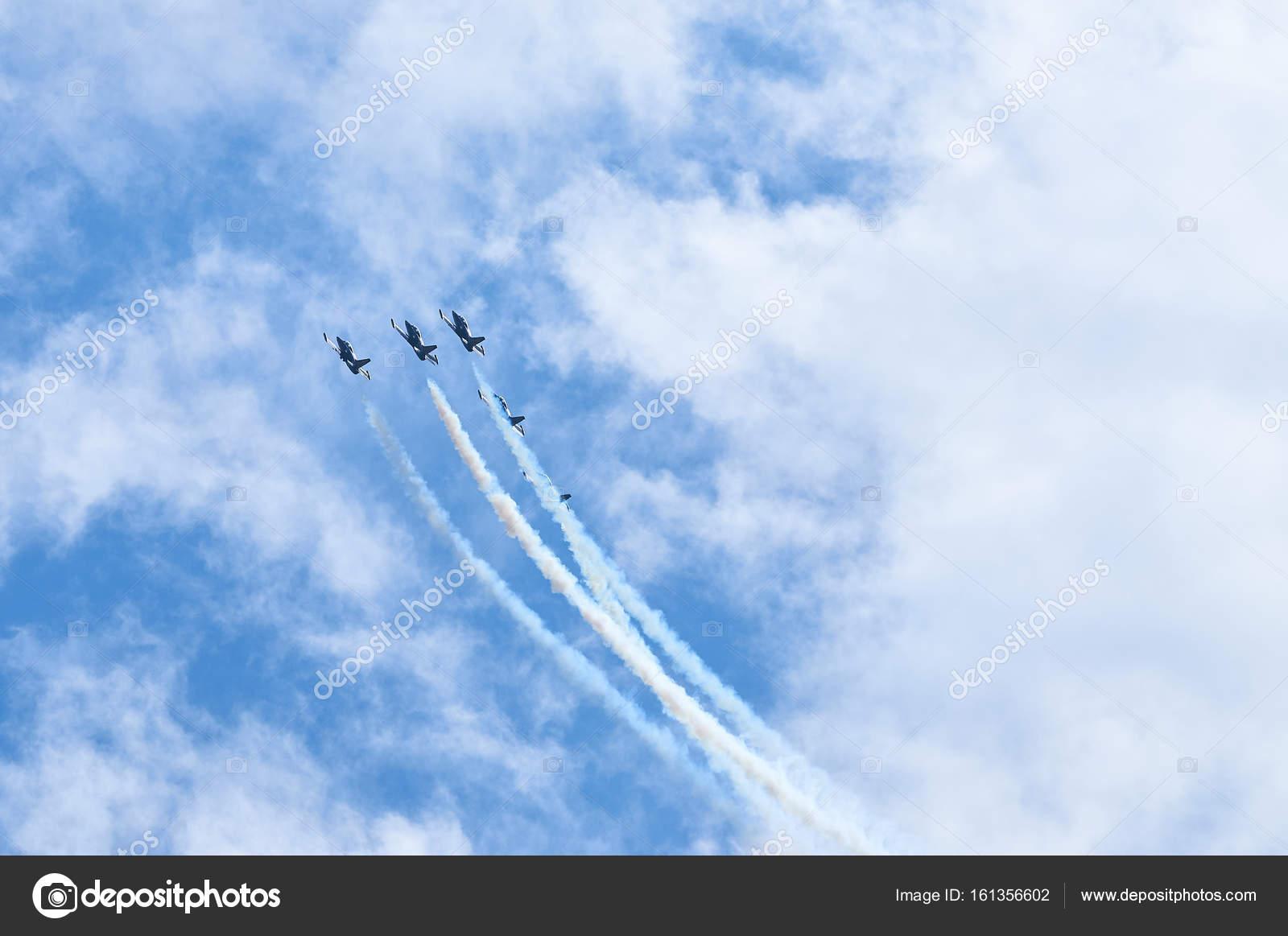 sport planes aerobatic team vapour trails in blue sky plane white vapour trails tracks background