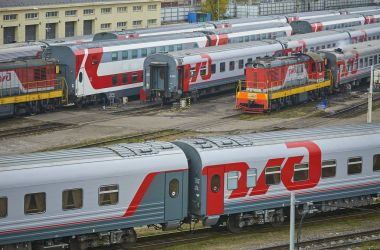 MOSCOW, RUSSIA, OCT,26, 2017: Russian Railways passenger trains in Rizhskaya depot under maintenance. Passenger train lines. RZD passenger coaches cars. Train coaches and shunter locomotive. RZD logo
