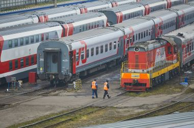 MOSCOW, RUSSIA, OCT,26, 2017: Russian Railways passenger trains in Rizhskaya depot under maintenance. Passenger train lines. RZD passenger coaches cars. Train coaches roofs. Shunter locomotive depot
