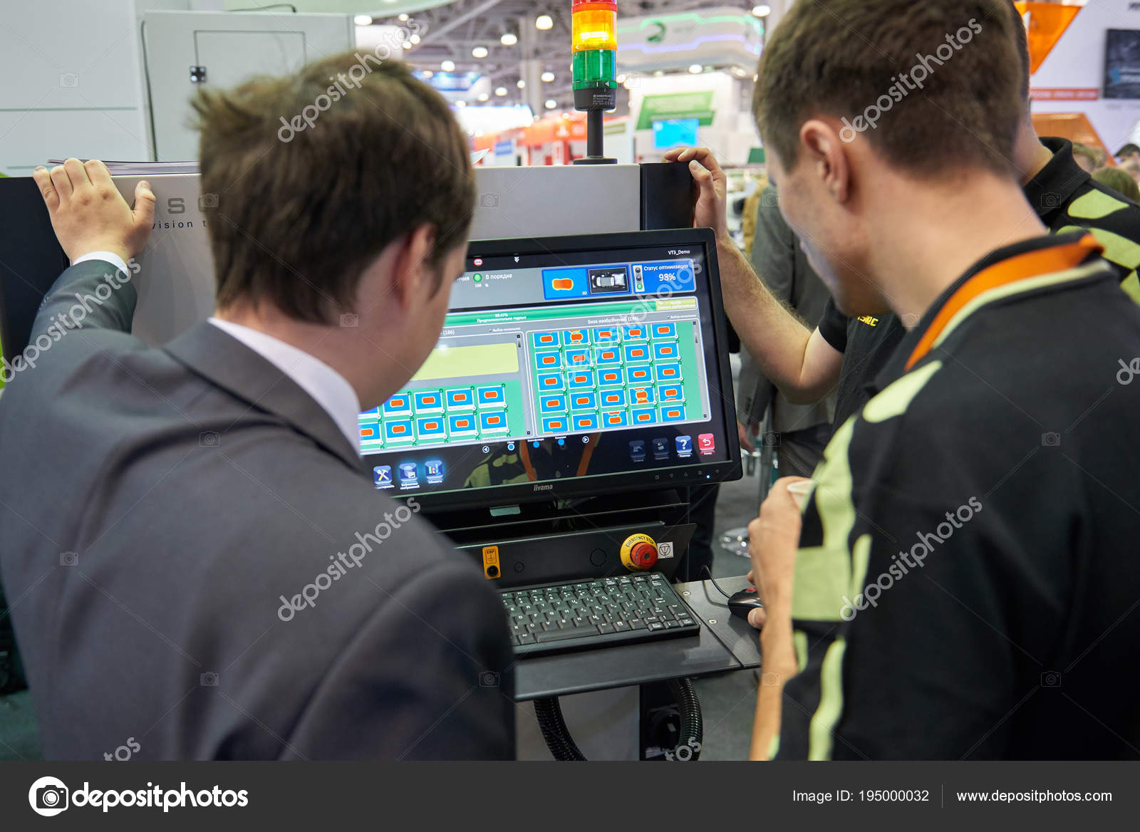 Moscow Apr 2018 Engineer Demonstrates Monitor How Work Machine Printed Circuit Board Manufacturing Equipment 19 On To For Manufacture Of Boards Computers Men At