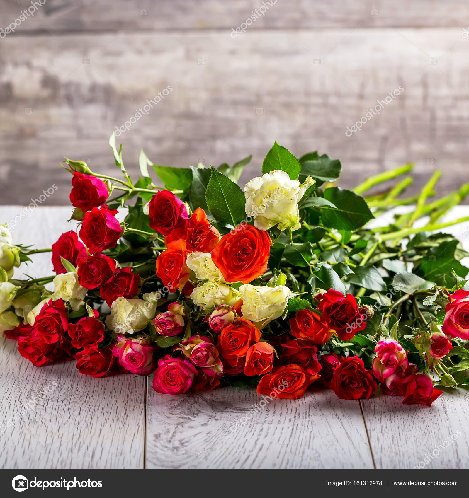 Bouquet of roses on the table multicolored roses stock photo bouquet of different color roses roses on the table gray background beautiful flowers photo by olenakoretska izmirmasajfo