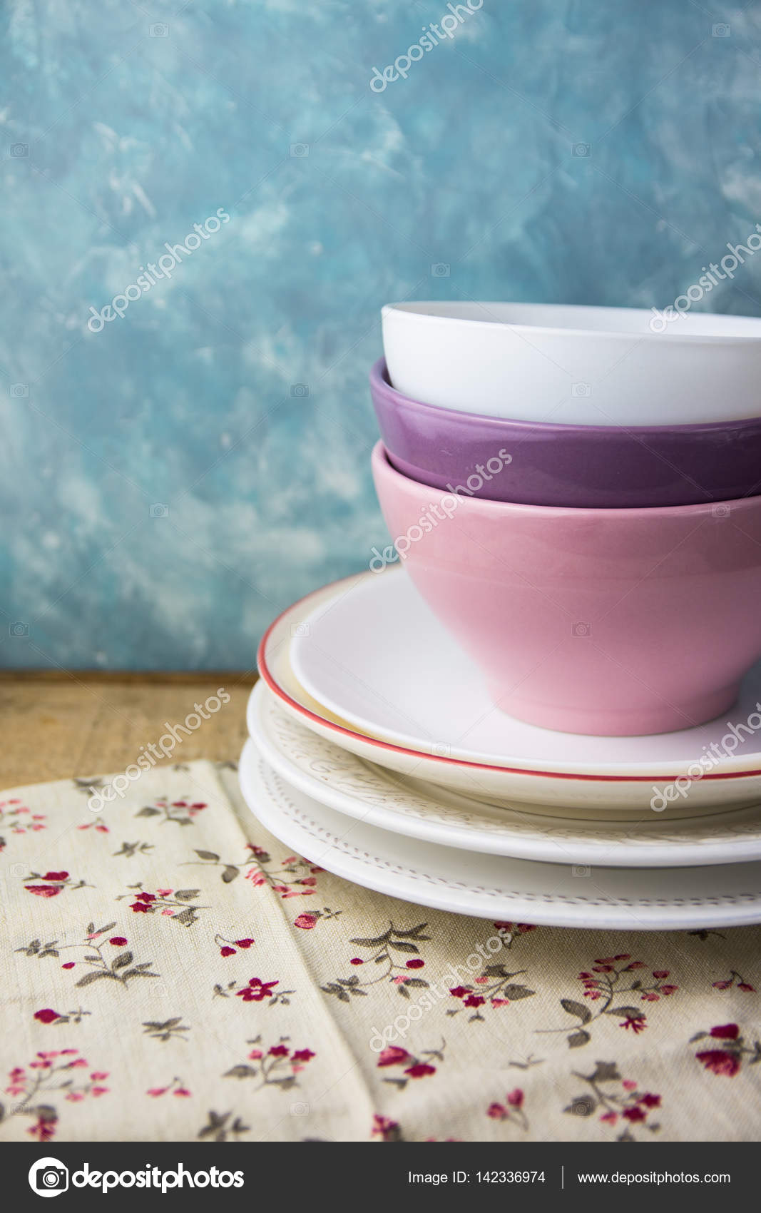 Stack of porcelain and ceramic plates and bowls on a wood kitchen ...