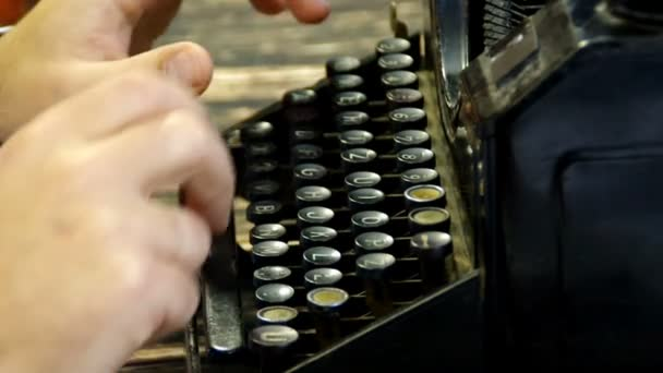 Hands typing on old writing machine. Fingers and vintage typewriter on desk. Loopable and seamless footage.