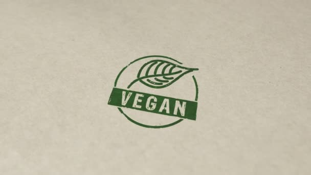 Vegan stamp and hand stamping impact animation. Life style, ecology, bio, natural food, vegetarian and healthy diet 3D rendered concept.