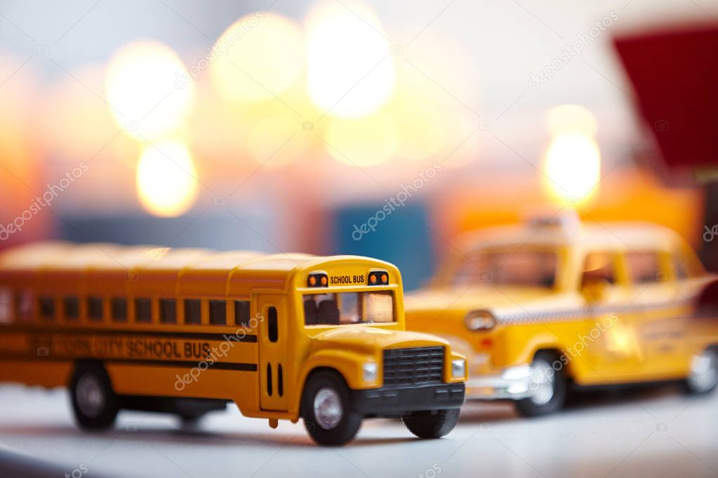 Collection of miniature copies of the car. Yellow car. Car. Auto. Bus. School bus