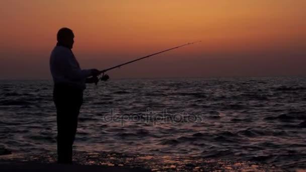 Západ slunce moře rybář