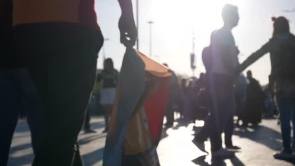 People walking sunset city