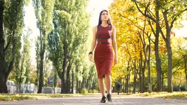 Woman walking park forest autumn