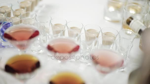 Pouring wine into glasses at a party