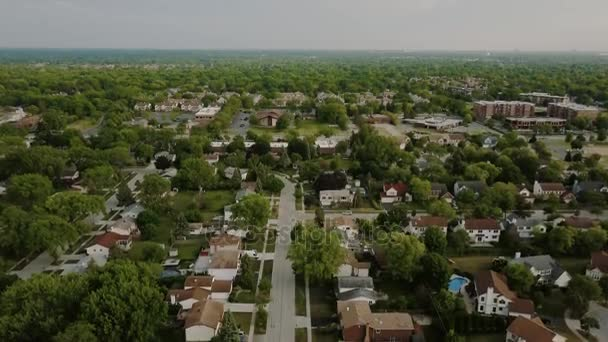 Aerial view of a suburban neighborhood. move drone down