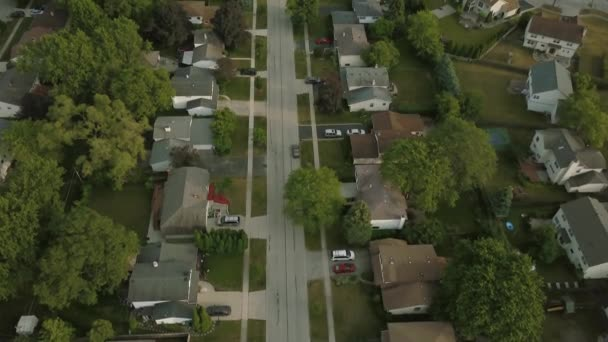 Aerial view of a suburban neighborhood. move drone over road