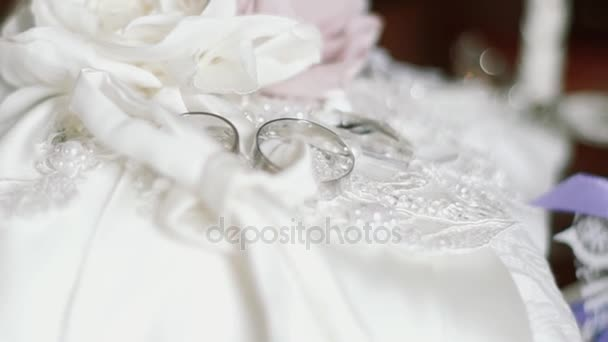 Wedding rings on a small white pillow