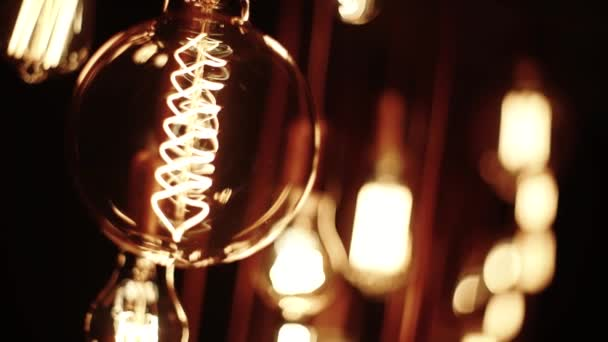 Old Lamp Incandescent lamp in antique style. Decorative antique edison style filament light bulbs hot spiral of tungsten bulb. close up
