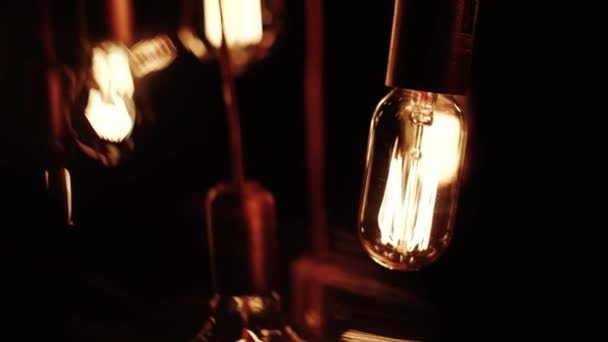 Old Lamp Incandescent lamp in antique style. Decorative antique edison style filament light bulbs hot spiral of tungsten bulb. slow motion camera
