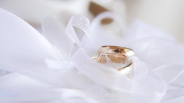 Wedding rings on a white pillow. Close up