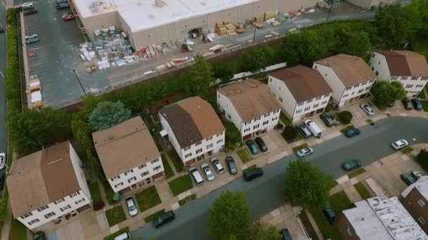 Aerial Top view Establishing shot of american neighborhood,, suburb and logistics center with warehouse. Real estate, drone shots,