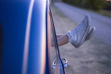 feet out of vintage car window