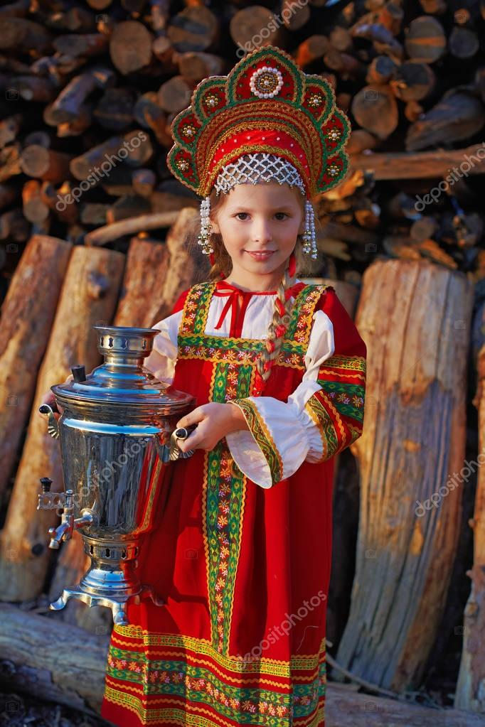 Small cute blonde girl in beautiful traditional Russian costume