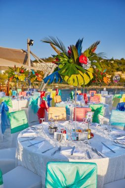 Festive served sea view terrace restaurant for corporate banquet
