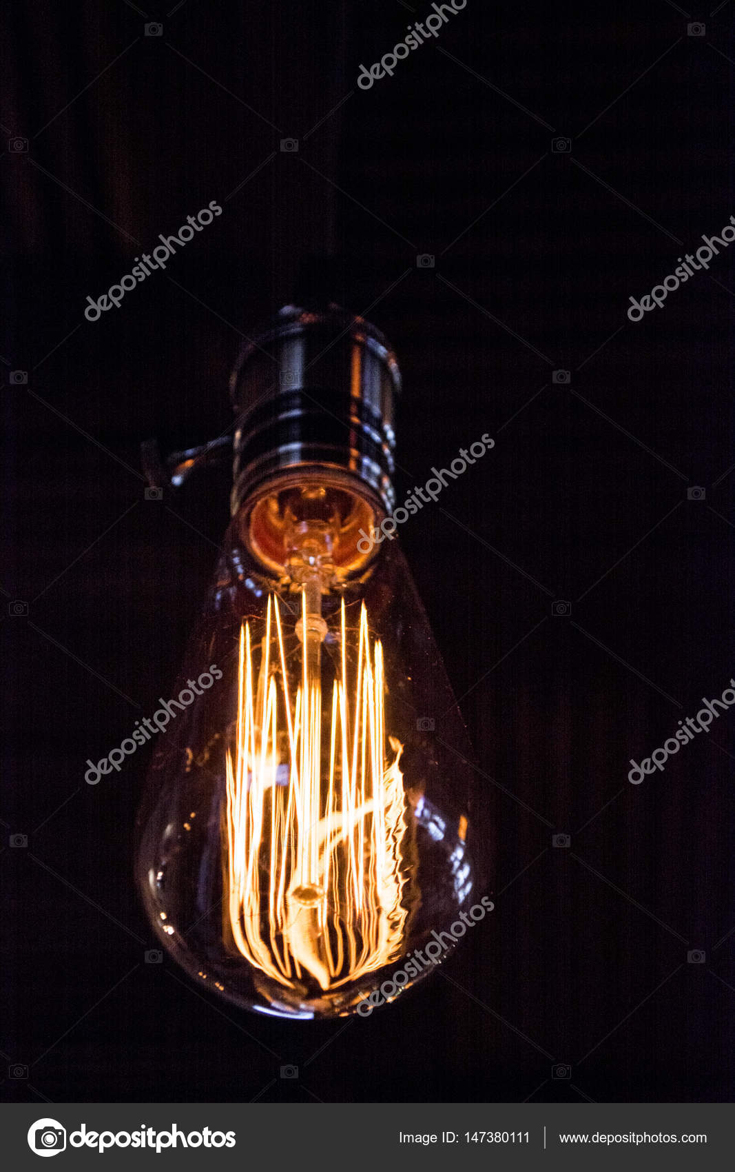 On a black background light bulb tesla place for the text these edison style bulbs are beautiful but are high consume electricity also