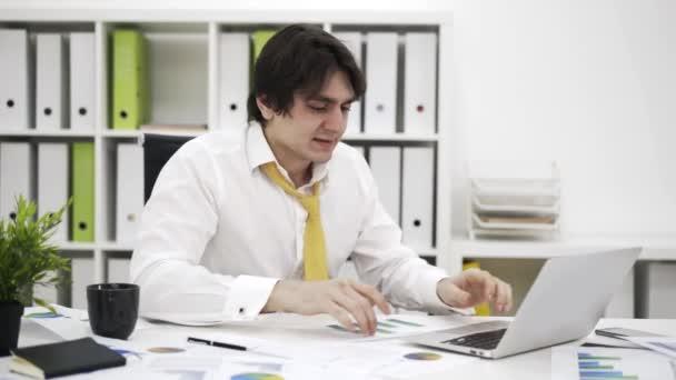 Stressed businessman typing