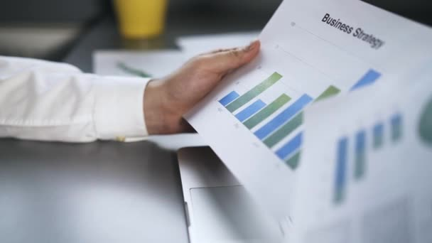 Close up of a man studying market research