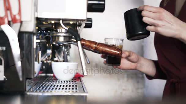 Close up of barista making coffee in a glass