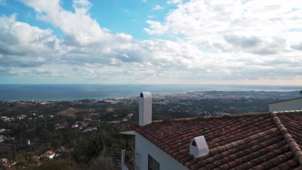Gimbal pan shot left to right of Mijas houses with sea view