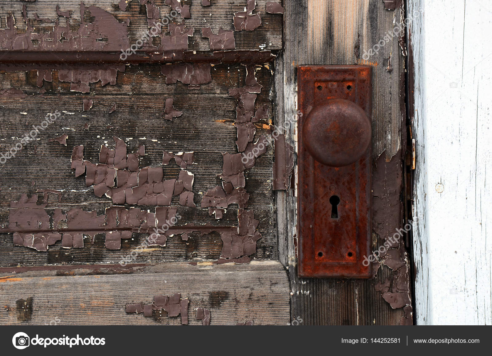 A Close Up Image Of An Old Rusted Antique Door Handle.