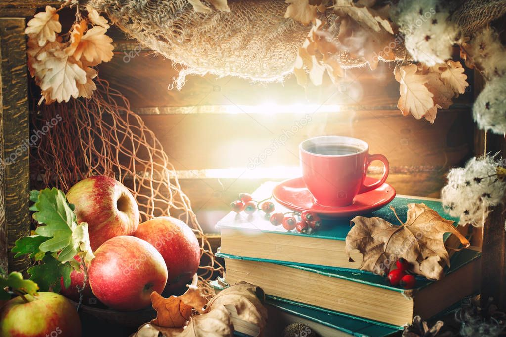 Autumn still life with a cup of coffee, apples and autumn leaves. Autumn background.