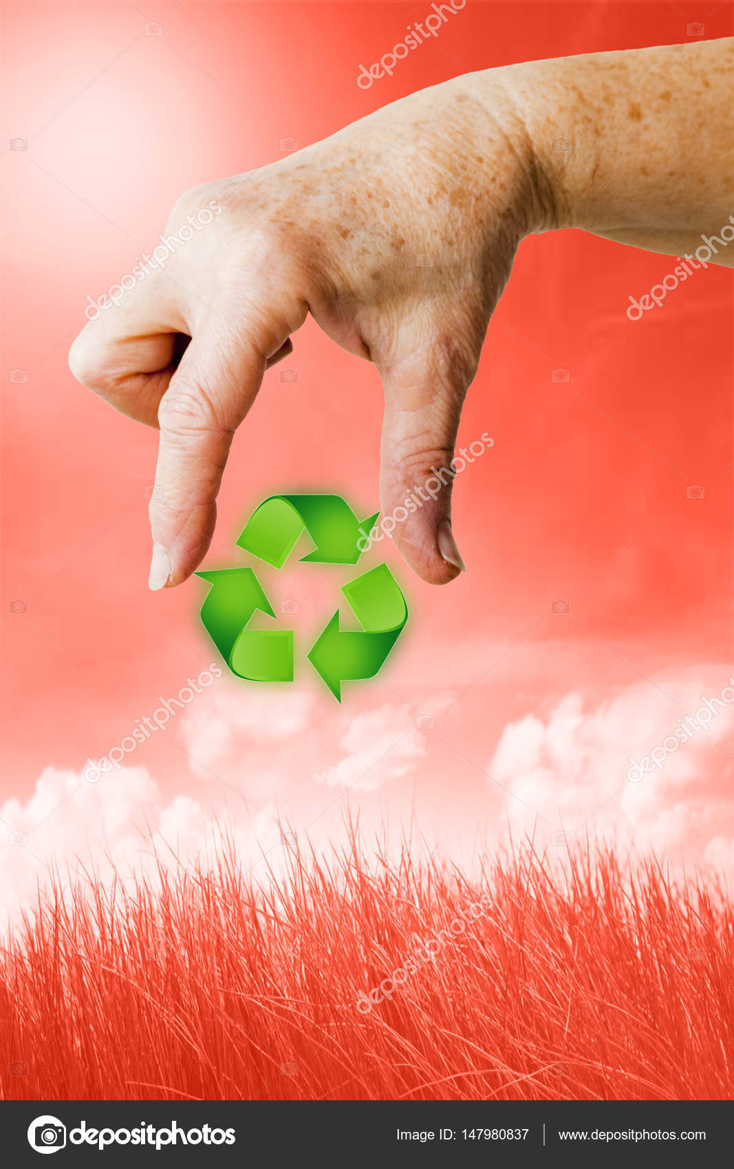 5bb5fa4e4b87 The hand of a woman is holding the symbol of recycling with two fingers.  Background is a beautiful but reddish and poisoned environment that needs to  be ...