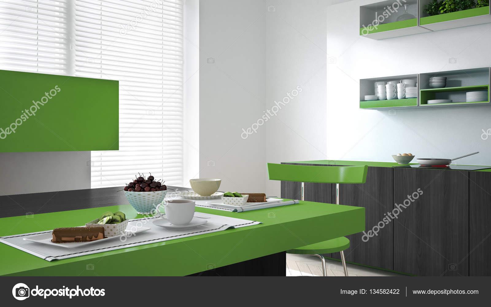 Minimalistische witte keuken met houten en groene details vegeta