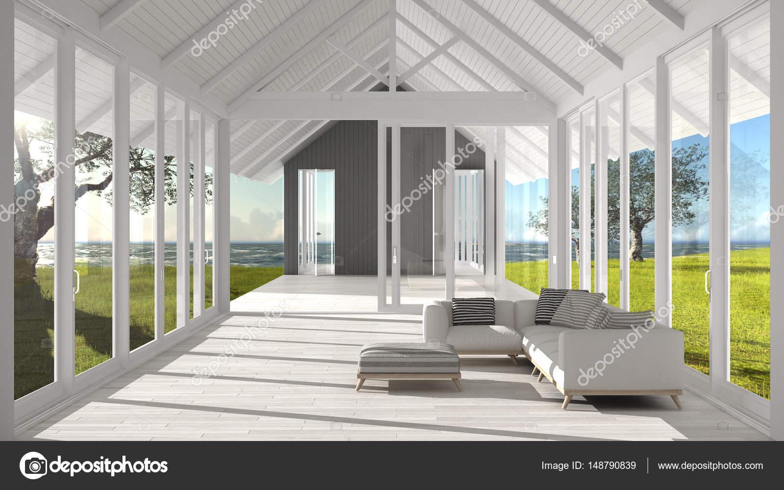 Minimalistische woonkamer met grote ramen glas en terra