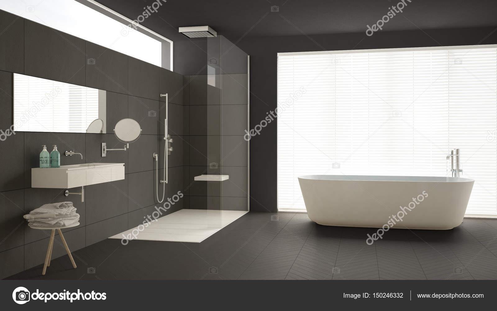 Stanza da bagno con vasca e doccia pavimento in parquet e m