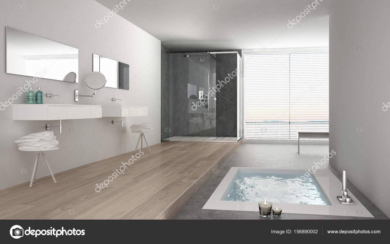 Minimalistische witte badkamer met bad en een panoramisch venster