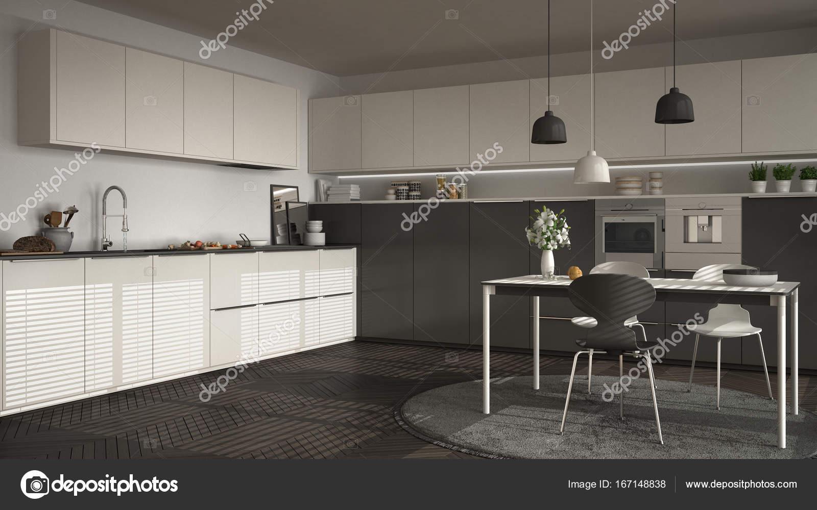 Cucina moderna con tavolo e sedie, grandi finestre e ...