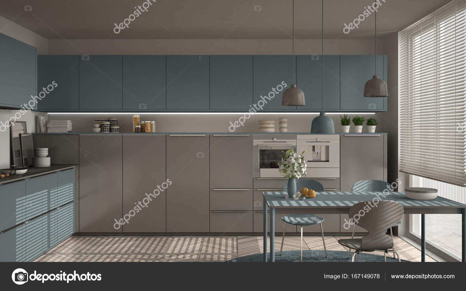 Moderne keuken met tafel en stoelen grote ramen en herringbon