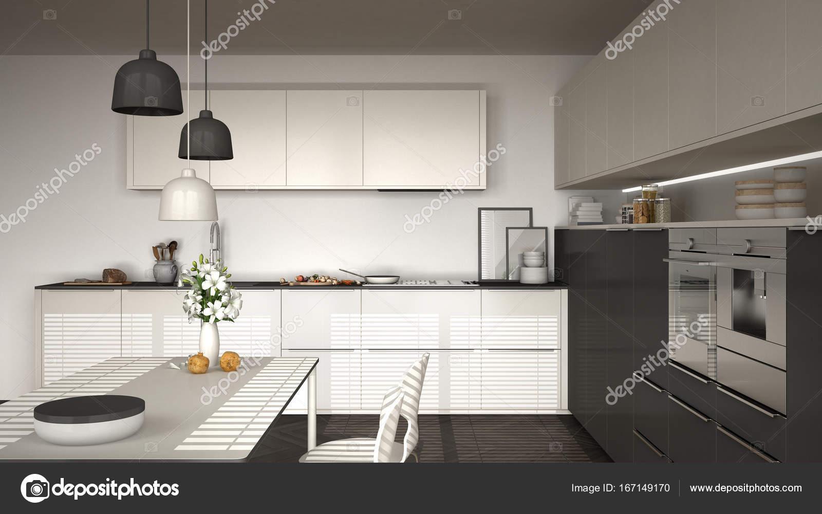 Cucina moderna con tavolo e sedie, pavimento in parquet a spina di ...