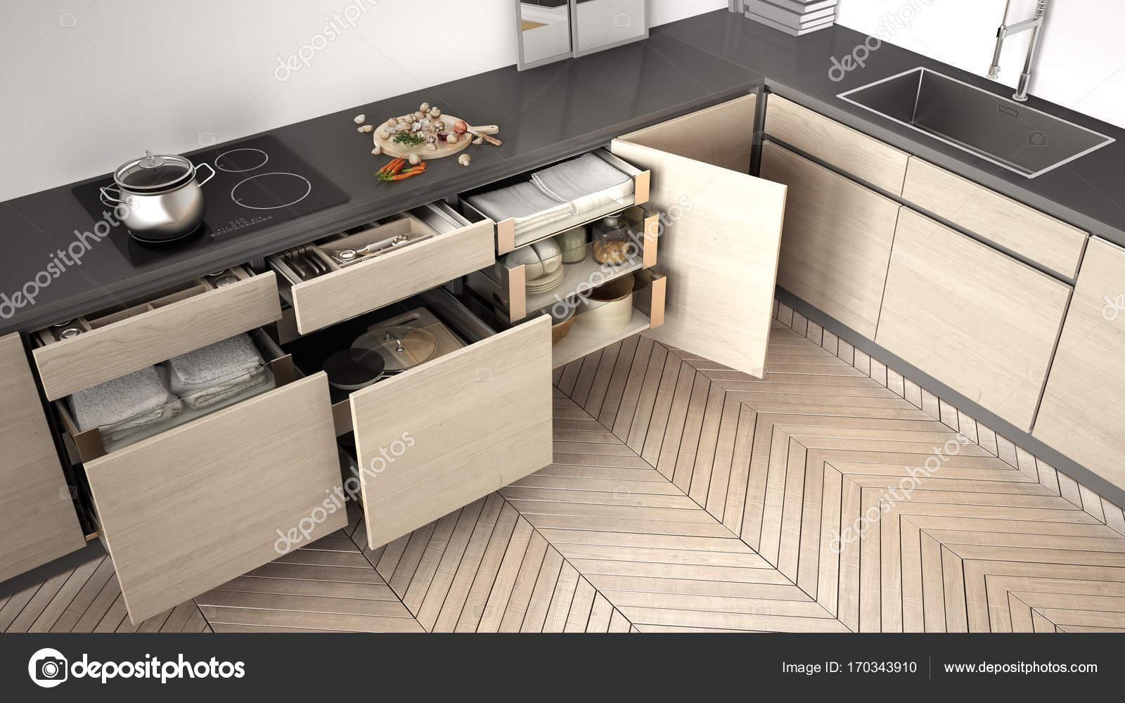 Vista superiore di cucina moderna, aperto cassetti in legno con ...