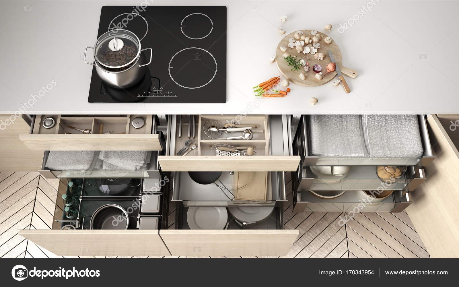 Hölzerne Küchenschublade eröffnet mit Zubehör in Lösung f ...